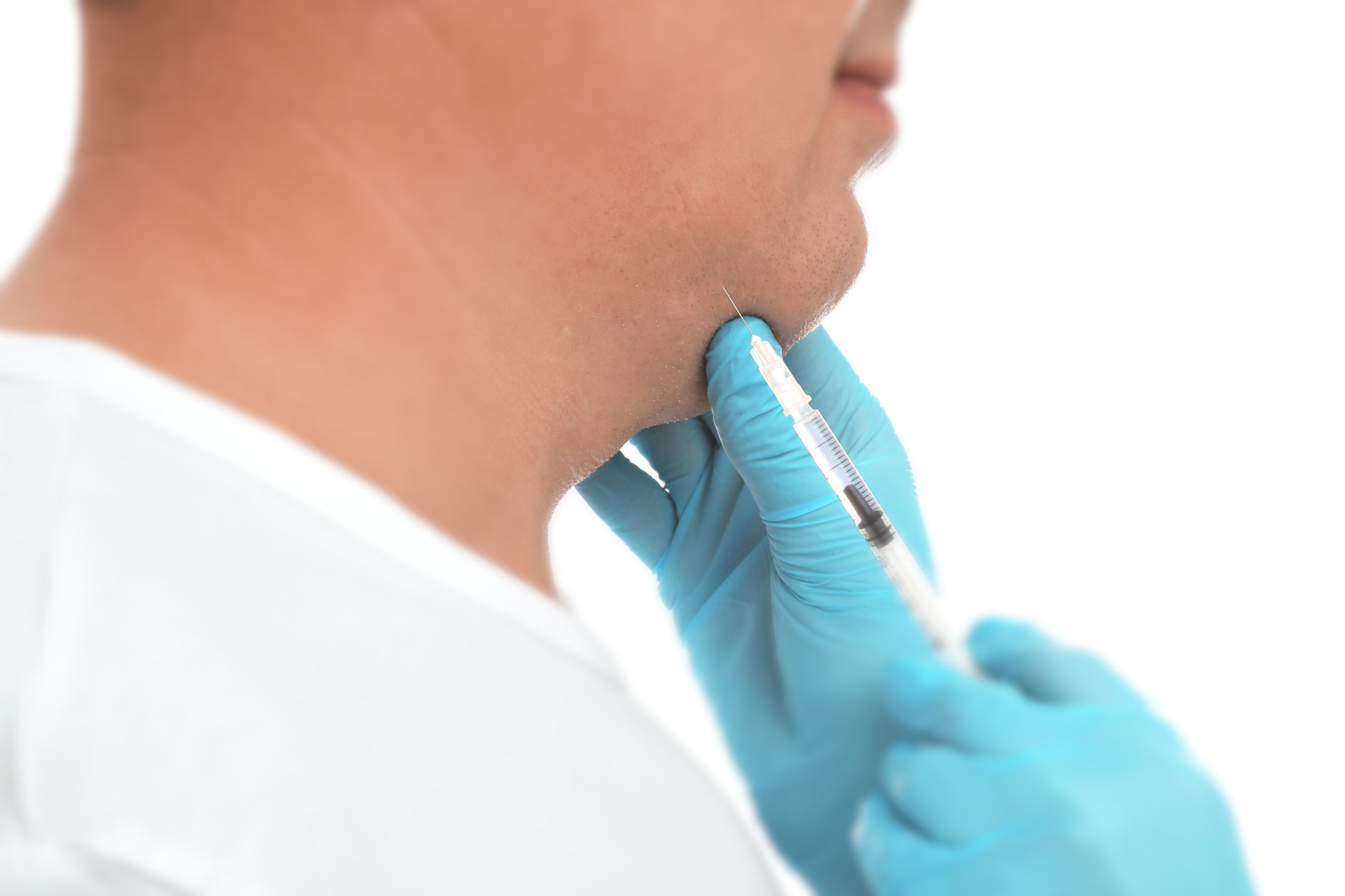 Mature man with double chin receiving injection on white backgro